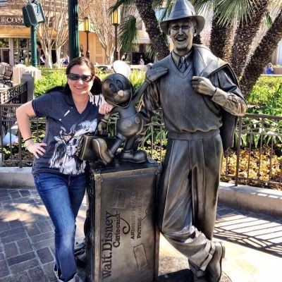 Posing with the Walt Disney statue at Disney's California Adventure