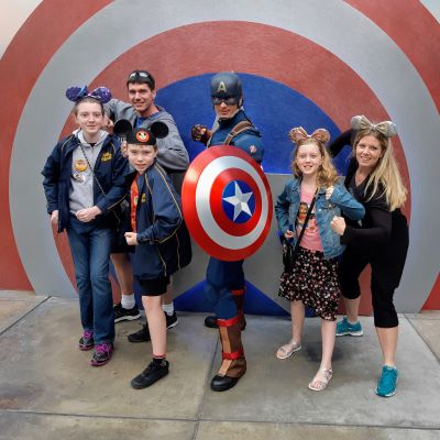 Posing for a picture with Captain America. My whole family and I are huge Marvel fans.