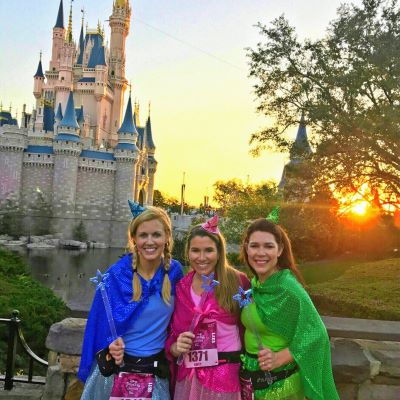 Posing at sunrise during our runDisney race