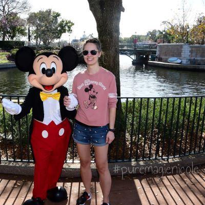 Saying 'cheese' with Mickey Mouse at Epcot