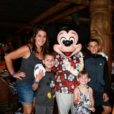 Fun family picture with Mickey Mouse at 'Ohana at the Polynesian Village Resort