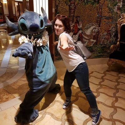 Posing with Stitch on a Disney Cruise
